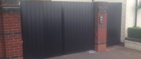 GREY COMPOSITE GATES IN STEEL FRAME & AUTOMATION